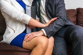 man_touching_womans_knee_sexual_harassment_in_office_cg1p59214013c_th